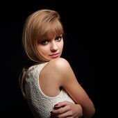 Beautiful Blond Woman Looking With Smile On Black Background
