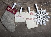 Vintage Christmas decorations and cards hanging on clotheslines