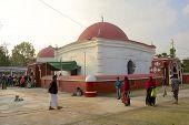 Unidentified pilgrims stand outside Ulugh Khan Jahan's mausoleum, Bagerhat, Bangladesh.