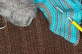 Gray Silky Yarn With Striped Crochet Hook