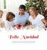 Cheerful family celebrating Christmas against feliz navidad