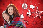 stock photo of blanket snow  - Mother and daughter under blanket against red snow flake background - JPG