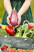 New year goodness against hands holding an aubergine
