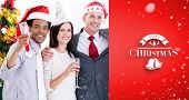 United business team drinking champagne to celebrate christmas against red vignette