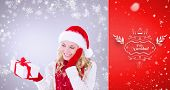 happy festive blonde with gift against red vignette
