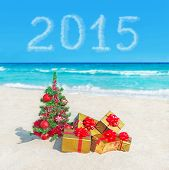 Christmas Tree And Golden Gifts At Sea Beach. Concept For New Year 2015