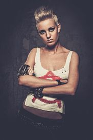 image of anarchists  - Punk girl with spiked bracelets  - JPG