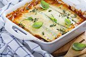 image of lasagna  - Healthy zucchini lasagna bolognese in a baking dish - JPG