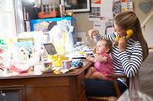 picture of untidiness  - Mother With Daughter Running Small Business From Home Office - JPG