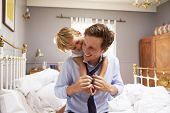 picture of hug  - Son Hugging Father As He Gets Dressed For Work - JPG