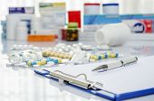 stock photo of paracetamol  - Lot of medicine pills and doctor note - JPG