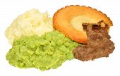 stock photo of mashed potatoes  - Meat pie and mashed potato meal with mushy peas isolated on a white background - JPG