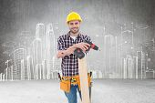 picture of hand drill  - Confident male carpenter with drill machine and plank against hand drawn city plan - JPG