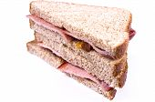 stock photo of bacon  - A typical English breakfast bacon butty made with bacon rashers  - JPG