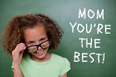 foto of pupils  - Cute pupil tilting glasses against green chalkboard - JPG