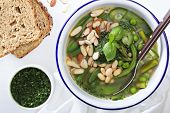 stock photo of green bean  - Minestrone soup with spring green vegetables and white beans - JPG