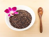 picture of ceramic bowl  - Rice Berry with Wooden Spoon on White Ceramic Bowl - JPG