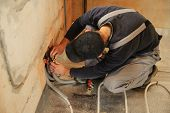 pic of floor heating  - Man working installer connects the underfloor heating pipes - JPG