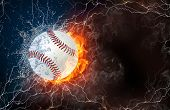 pic of softball  - Softball ball on fire and water with lightening around on black background - JPG