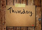 stock photo of thursday  - Thursday on note paper with wooden background - JPG