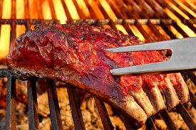 picture of braai  - Grilled BBQ Tasty Spicy Smoked Marinated Pork Ribs At Summer Party - JPG