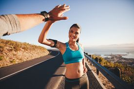 picture of pov  - Fit young woman giving high five to her boyfriend after a run - JPG
