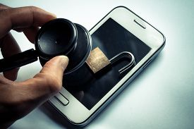stock photo of check  - hand using a stethoscope to check smartphone system  - JPG