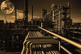 stock photo of refinery  - oil and gas refinery at midnight - JPG