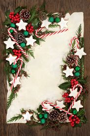 foto of candy cane border  - Christmas abstract background border with candy cane and gingerbread biscuits - JPG