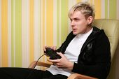 excited young adult playing video game