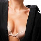 attractive female breasts in bra and black shirt isolated on white background