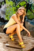 Portrait of a blond model with graffiti background
