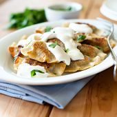 Pierogi with sour cream