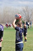 Player Perparing To Throw A  Overhead Pass For A Lineout In A Women's College Rugby Match