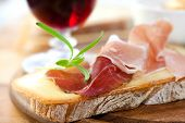 Delicious canape with french cheese and prosciutto