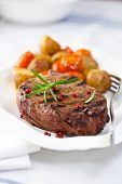 Grilled steak with baked vegetables and fresh rosemary