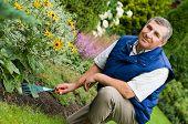 Man raking garden