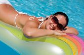 stock photo of beautiful young woman  - Young woman in the pool - JPG