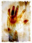 hand on burnt paper