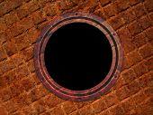 Round window on grunge wall, illuminator