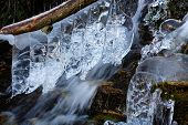 Detail of a mountain frozen torrent, west Alps.