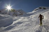 A lone backcountry skier (ski touring), west alps, Europe.