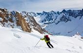 Male skier moving down in snow powder; envers du plan, vall?e blanche, Chamonix, Mont Blanc massif, France, Europe.