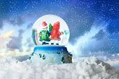 Christmas snow globe on winter snowy sky