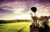 picture of golf  - Professional golf gear on the golf field at sunset - JPG