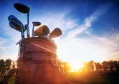 foto of golf  - Professional golf gear on the golf course at sunset - JPG