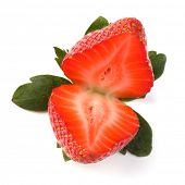 Halved strawberry isolated on white background