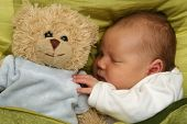 stock photo of teats  - dreaming newborn baby  - JPG