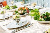 image of catering  - catering table set service with silverware and glass stemware at restaurant before party - JPG