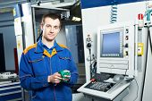 mechanical technician near cnc milling machine center at tool workshop